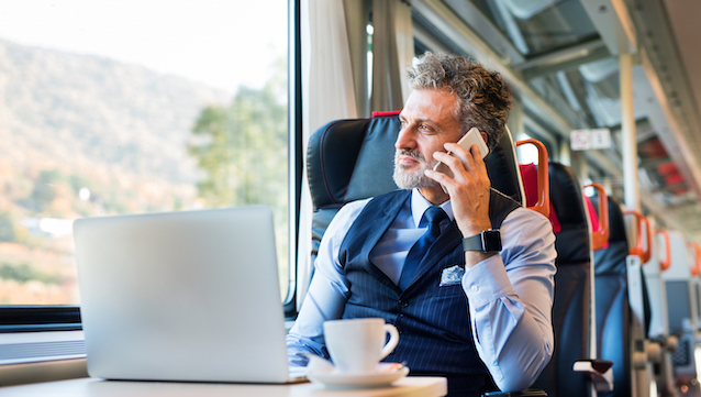 Mature,Businessman,With,Smartphone,Travelling,By,Train.