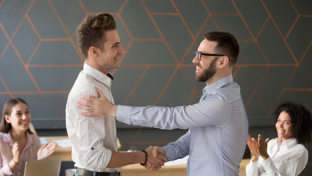Team,Leader,Handshaking,Employee,Congratulating,With,Professional,Achievement,Or,Career